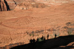 Shadow Hikers on Red Rock Royalty Free Stock Images