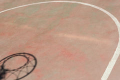 Shadow of the hoop in basketball court Royalty Free Stock Photo