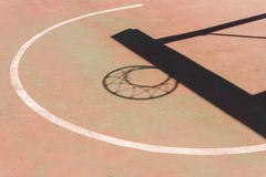 Shadow of the hoop and board in basketball court Royalty Free Stock Image