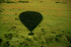 Shadow of hot air balloon. Over the Masai Mara Stock Images