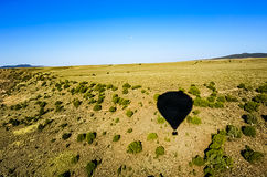 The shadow of a hot Air Balloon. Flying across the Rio Grande in Taos New Mexico royalty free stock images