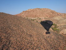 Shadow of hot air balloon over the desert Royalty Free Stock Images