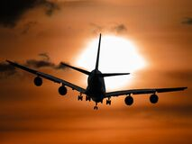 Shadow Image of a Plane Flying during Sunset Royalty Free Stock Images