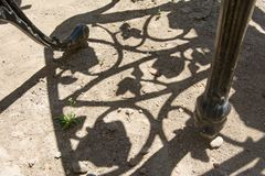 Shadow of iron chair ornaments Royalty Free Stock Images