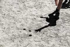 Shadow of a juggler. On gray ground royalty free stock images