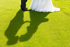 Bride and groom kiss. Shadow of the kiss of the bride and groom Royalty Free Stock Images