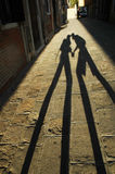 Shadow of kissing lovers Stock Images
