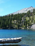 Shadow Lake, Lassen Peak. Log at Shadow Lake with Lassen Peak, Lassen Volcanic National Park Stock Photography