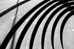 Shadow and light. Shadow at play forming beautiful curves and straight lines along some steps Royalty Free Stock Photo