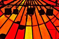 Shadow of light instalation and stained-glass windows in vibrant red colors Royalty Free Stock Image