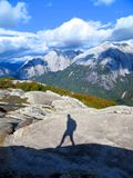 Shadow of a Lonely Hiker in the Mountains Stock Photos