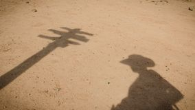 Shadow of a lost cowboy and a sign stock images