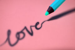 Shadow love. Shadow written love on pink background stock image