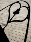 Shadow of Love. Shadow of heart with a bell in the middle Stock Image