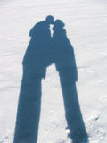 Shadow of lovers. Shadow in the snow of loving couple Royalty Free Stock Images