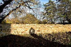 Shadow of loving couple on a brick wall Royalty Free Stock Photo