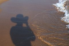 Shadow of man on the beach. Stock Photography