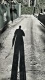Shadow of a man coming home Royalty Free Stock Images