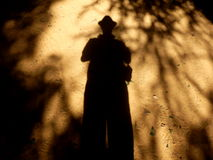 Shadow Man. Eerie picture of a shadow man on sandy ground Royalty Free Stock Photography