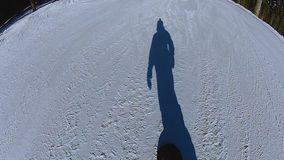 Shadow of man enjoying snowboard ride on snowy slope, vacation in mountains. Stock footage stock video footage