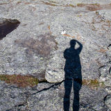 Shadow of man on granite rock Stock Image
