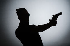 The shadow of the man with gun. Shadow of the man with gun stock images