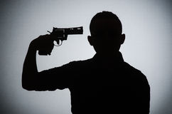 The shadow of the man with gun. Shadow of the man with gun Royalty Free Stock Images