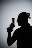 The shadow of the man with gun. Shadow of the man with gun stock photo