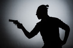The shadow of the man with gun. Shadow of the man with gun stock image