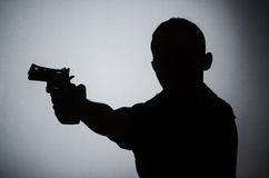 The shadow of the man with gun. Shadow of the man with gun Royalty Free Stock Photos