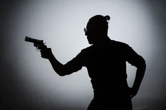 The shadow of the man with gun. Shadow of the man with gun Royalty Free Stock Image