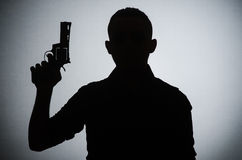 The shadow of the man with gun. Shadow of the man with gun royalty free stock photography