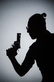Shadow of the man with gun. The shadow of the man with gun stock photo