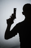Shadow of the man with gun. The shadow of the man with gun Royalty Free Stock Photos