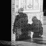Shadow of a man and his mother walking into a temple. Shadows of man and a woman projected of the entrence of Tomb of I`timād-ud-Daulah in Agra. Mosaics of baby Royalty Free Stock Photo