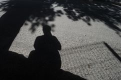 The shadow of a man holding a camera, self-portrait of a tourist photographer. royalty free stock images
