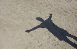 Shadow of man with open arms. On sand background in Bodrum Turkey Stock Image