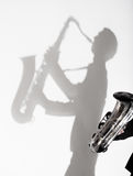 Shadow of man playing on saxophone Stock Image