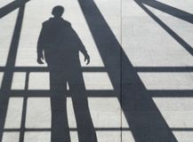 Shadow of a man on the sidewalk Royalty Free Stock Images