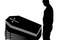 Shadow of a man. Silhouette of a man looking at a black and grey casket Stock Photo
