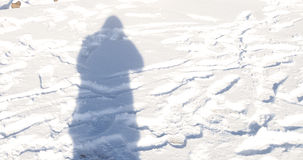 Shadow of a man on snow Royalty Free Stock Photos