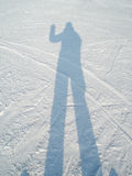 Shadow of a man in the snow. Man waving Stock Photo