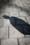 Shadow of a man standing Royalty Free Stock Photos