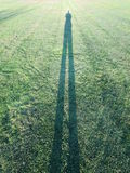 Shadow of a man standing in a park. Shadow of a man taking his own photograph stock photography