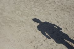 Shadow of man standing on sand background. Shadow of man standing on sand background in Bodrum Turkey Stock Images