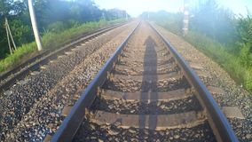 Shadow of a man walking on a railway. stock video