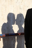 Shadow of the man and the woman who kissing on dirty wall Stock Photo