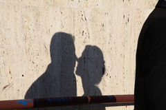 Shadow of the man and the woman who kissing on dirty wall Royalty Free Stock Photography