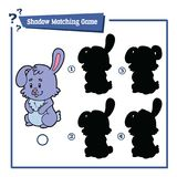 Shadow matching game with cartoon bunny. Vector illustration of educational shadow matching game with cartoon character for children Royalty Free Stock Image