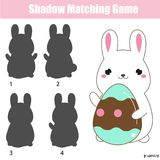 Shadow matching game. Easter theme activity for kids and toddlers. Rabbit holding egg. Shadow matching game for children. Shadow matching game. Easter theme Stock Images